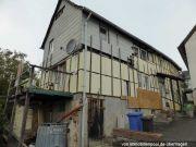 Titelbild Zwangsversteigerung Einfamilienhaus und drei Grundstücke