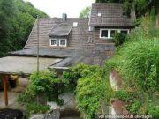Einfamilienhaus und unbeb. Grundstücke