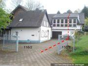 Titelbild Zwangsversteigerung Einfamilienhaus und unbeb. Grundstücke