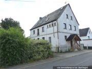 Titelbild Zwangsversteigerung zwei Wohnungen und ein Grundstück