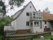 Titelbild Zwangsversteigerung Einfamilienhaus mit Stall- und Scheunengebäude