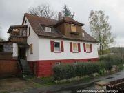 Titelbild Zwangsversteigerung Einfamilienhaus und Schopfgebäude