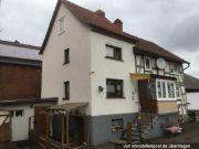 Titelbild Zwangsversteigerung Einfamilienhaus und unbebautes Grundstück
