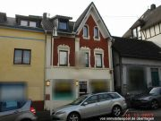 Titelbild Zwangsversteigerung Wohn- und Geschäftshaus und unbebautes Grundstück