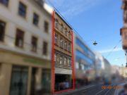 Titelbild Zwangsversteigerung Wohn- und Geschäftshauskomplex, unbeb. Grundstück