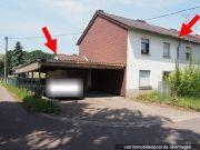 Einfamilienhaus und unbebautes Grundstück