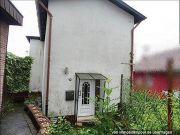 Titelbild Zwangsversteigerung Einfamilienhaus und überbautes Grundstück
