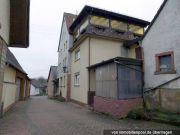 Titelbild Zwangsversteigerung Wohnhaus und zwei Grundstücke