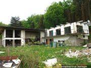 Titelbild Zwangsversteigerung Wohnhaus und unbeb. Grundstücke