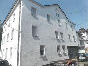 Titelbild Zwangsversteigerung Mehrfamilienhaus und Grundstücksanteil