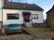 Einfamilienhaus und Grundstück