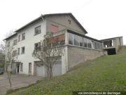 Titelbild Zwangsversteigerung Mehrfamilienhaus mit Nebengebäude
