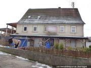 Bild zu Wohnhaus und unbebautes Grundstück
