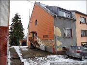 Titelbild Zwangsversteigerung Einfamilienhaus und weitere Grundstücke