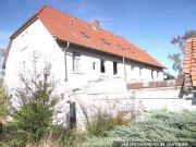 Titelbild Zwangsversteigerung Mehrfamilienhaus und unbeb. Grundstücke