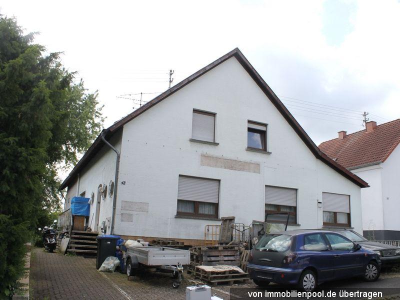 Zwangsversteigerung Wohn-/Geschäftshaus und unbeb. Grundstück