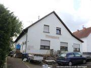 Wohn-/Geschäftshaus und unbeb. Grundstück