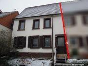 Einfamilienhaus und Scheune mit Anbau