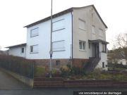 Titelbild Zwangsversteigerung Wohnhaus und unbeb. Grundstück