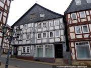 Wohn-/Geschäftshaus, Garage, unbebautes Grundstück