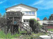Titelbild Zwangsversteigerung Einfamilienhaus mit Werkstattanbau