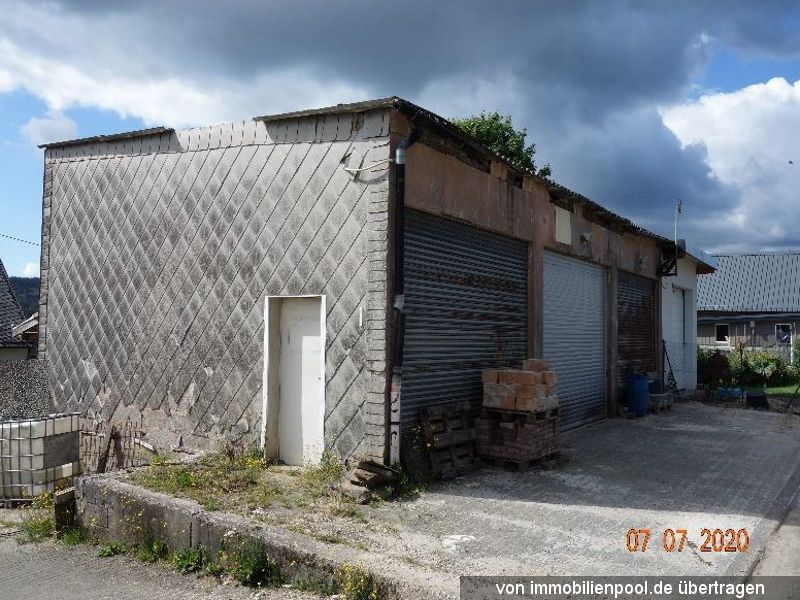 Titelbild Zwangsversteigerung Garage u. Garage mit Grillhütte