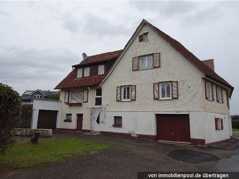 Zwangsversteigerung Zweifamilienhaus und unbebautes Grundstück