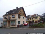 Titelbild Zwangsversteigerung Wohn- und Geschäftshaus und Einfamilienhaus